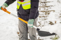 Man shoveling snow on stairs. In winter day Stock Photography