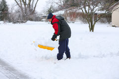Man shoveling snow Stock Photos