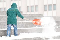 Man shoveling winter snow Stock Image