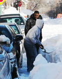 Man shovelling the aftermath of a winter blizzard Royalty Free Stock Images