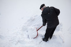 Man shovelling fresh snow Stock Images