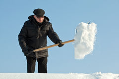 Man shovelling snow Stock Images