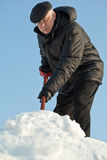 Man shovelling snow from a road Stock Photo