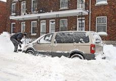 Man shovelling after snowstorm Stock Photos