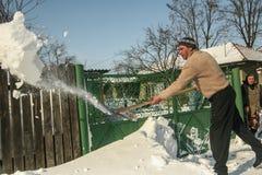 A man shovels snow Stock Image
