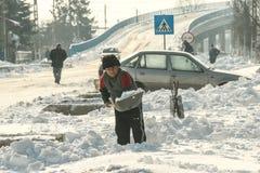 Man shovels snow Royalty Free Stock Photos