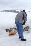 A man shovels snow Royalty Free Stock Photo