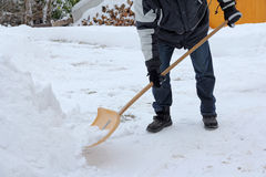 A man shovels snow Stock Images