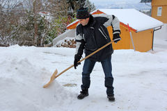 A man shovels snow Stock Image