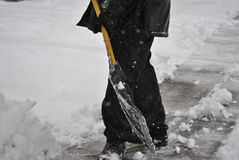 Man shovels snowa Royalty Free Stock Photos