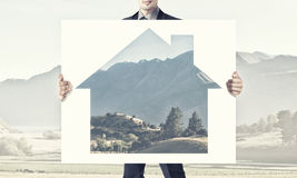 Man show banner with construction concept Stock Photography