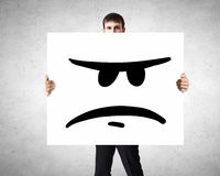 Man show banner with upset smiley Royalty Free Stock Photo