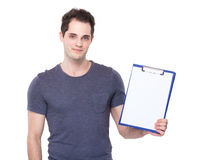 Man show with blank paper of clipboard Stock Image