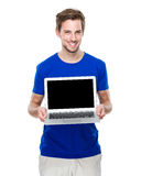 Man show with blank screen of laptop computer. Isolated on white background Stock Image