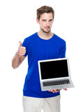 Man show with blank screen of laptop computer and thumb up Stock Photos