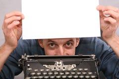 Man show blank sheet 2. Man show blank white sheet 2 Royalty Free Stock Photo