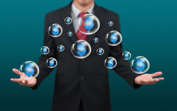 Man show dollar symbol in bubble Stock Photos