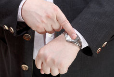 Man show exact time on wristwatch close up. Businessman show exact time on wristwatch close up - hand gesture Royalty Free Stock Photos
