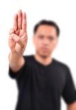 Man show 3 finger for anti dictator stock photos