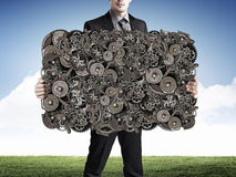 Man show gear banner. Unrecognizable businessman showing banner with gears mechanism concept Stock Photography