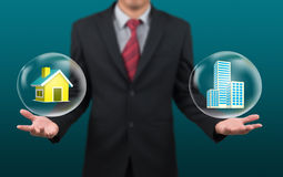 Man show house and condominium in bubble Stock Image