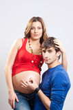 Man show ok sign on pregnant belly Royalty Free Stock Photos