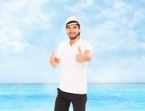 Man show thumb up hand gesture hat backpack Stock Photography