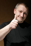 Man show thumb up sign Stock Images