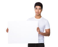 Man show with white poster Stock Images