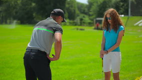 The man show the woman position in golf stock footage