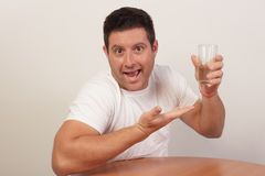 Man showcasing his cup of water Royalty Free Stock Photography