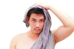 Man after shower in bathroom,isolated on white background. Isolated on white background Stock Photo