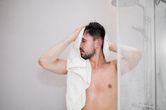 Man at the shower Stock Image