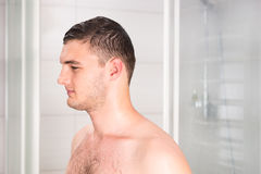 Man after shower standing in the bathroom Stock Images