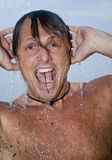 Man showering Stock Image