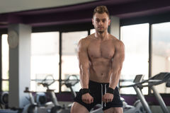 Man Showing Abdominal Muscle. Healthy Man Standing Strong In The Gym And Flexing Muscles - Muscular Athletic Bodybuilder Fitness Model Posing After Exercises royalty free stock images