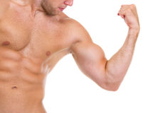 Man showing abdominal muscles and biceps Stock Photo