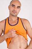 Man showing abs. Royalty Free Stock Photos