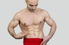 Man showing abs. Stock Image