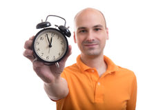 Man showing an alarm clock Stock Image