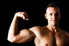 Man showing biceps Stock Images