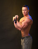 Man showing biceps muscle Stock Photography