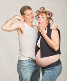 Man Showing Biceps to Pregnant Woman Stock Image