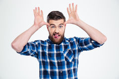 Man showing big ears with his hands and tongue Stock Photography