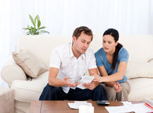 Man showing a bill to his girlfriend Royalty Free Stock Photos