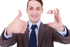 Man showing a blank business card Stock Photo