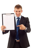 Man showing a blank clipboard Stock Photo