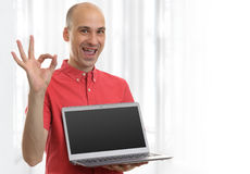 Man showing blank laptop computer. And ok sign stock photography