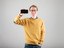 Man showing blank screen of his phone Stock Image