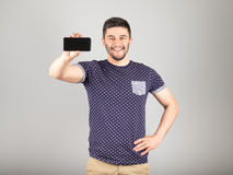 Man showing blank screen of his phone Stock Photography